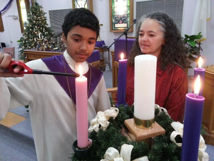 Acolyte lighting the advent candle