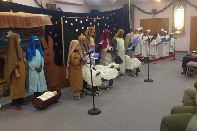 Trinity children recount the birth of Jesus in their Christmas pageant, entitled Starry Night.